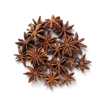 Star Anise – Heap of Chinese Star Aniseed, Aromatic Ingredient – Top View, Close-Up Macro, from Above – Isolated on White Background