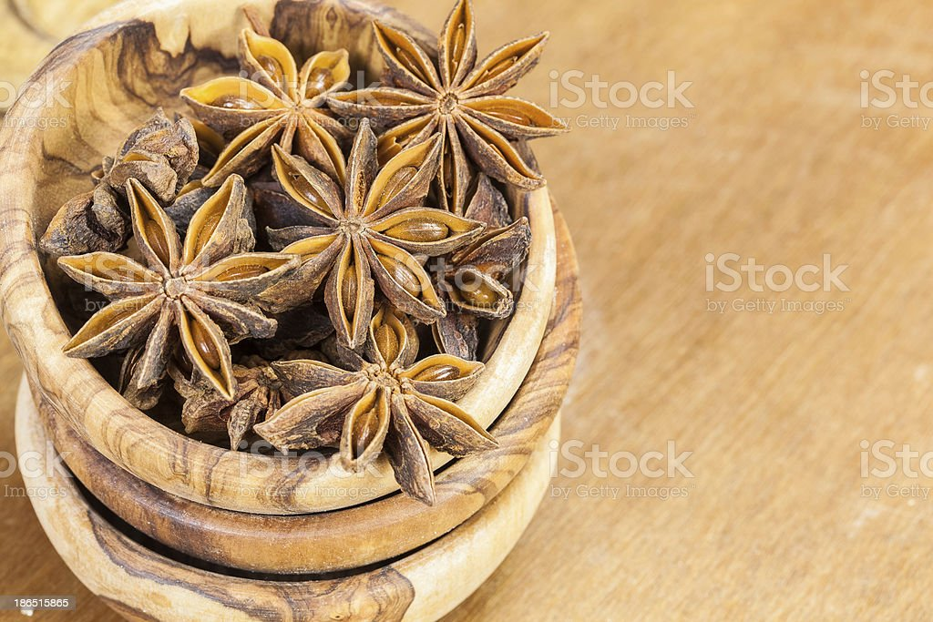 Star anise in olive wood bowl royalty-free stock photo