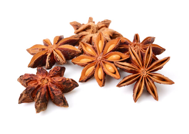 Star anise isolated on white Star anise isolated on white star anise stock pictures, royalty-free photos & images