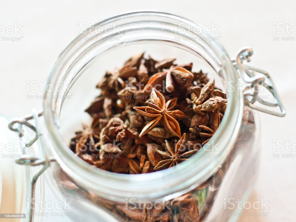 star anise star anise jar ready to flavor your recipes or your drinks Anise Stock Photo