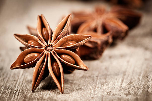 Star Anise Star anise exotic spice on a old wooden table star anise stock pictures, royalty-free photos & images