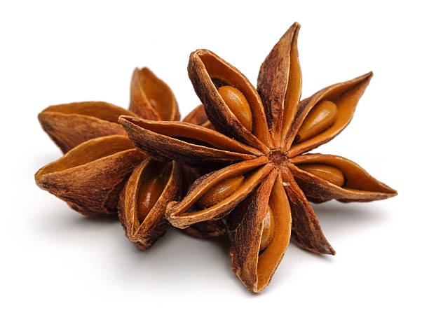Star Anise Star anise on a white background star anise on white stock pictures, royalty-free photos & images