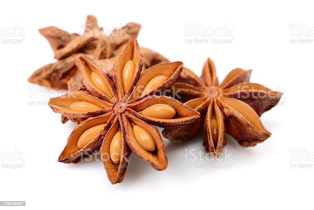 Star anise Star anise on a white background, casting soft shadow.  Anise Stock Photo