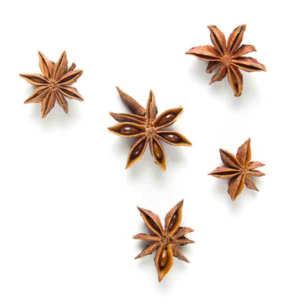 Star anise, scattered in a chaotic manner, isolated on white background Set star anise, isolated on white background star anise stock pictures, royalty-free photos & images