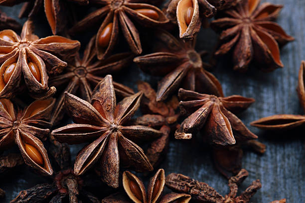 star anise seeds on the wooden background - 八角 個照片及圖片檔