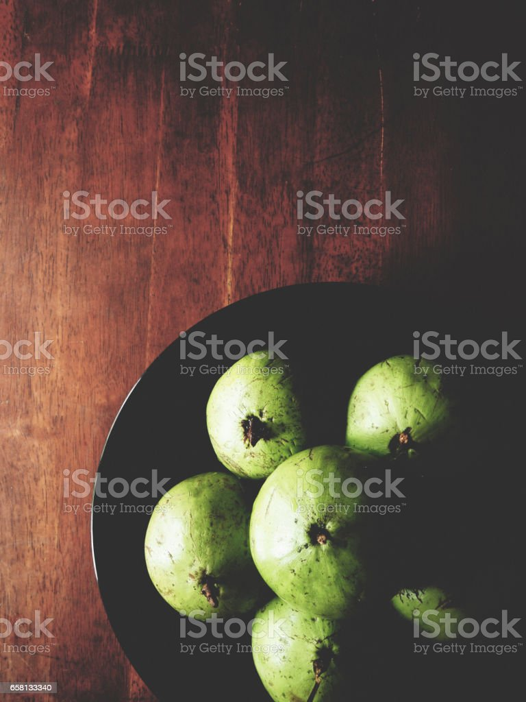 Star apple on the wooden table royalty-free stock photo