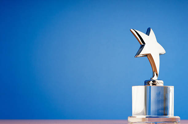 star award against gradient background - trophy award stock photos and pictures