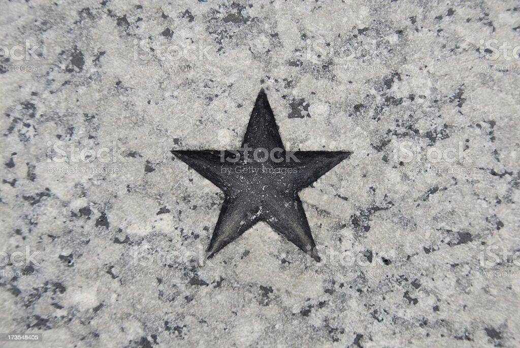 Star carved in granite. stock photo