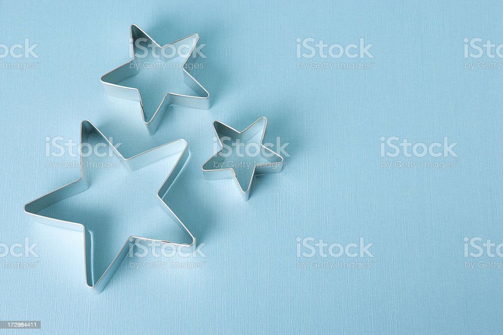 Star cookie cutter outline on blue royalty-free stock photo
