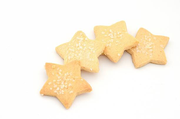 star cookie in coffee break time capuccino coffee in vintage style cup and star cookie in coffee break time sugar cookie stock pictures, royalty-free photos & images