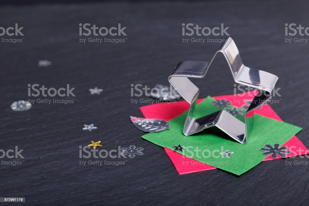 Star cookies cutter on black slate plate stock photo