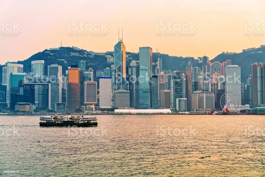 Star ferry in Victoria Harbor of Hong Kong at sundown stock photo