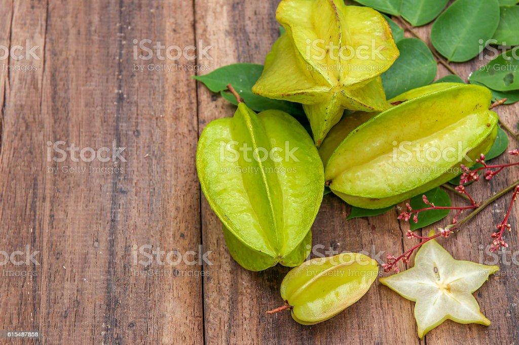 Star fruit on wood background ,starfruit on wooden background stock photo