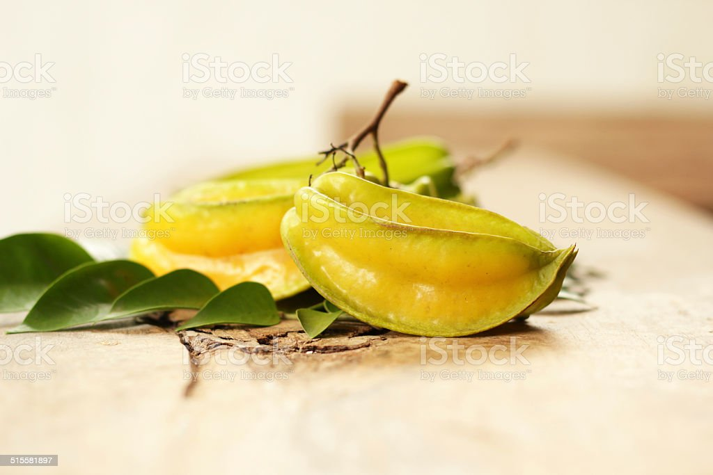 star fruit.Star fruit put on wooden board. stock photo