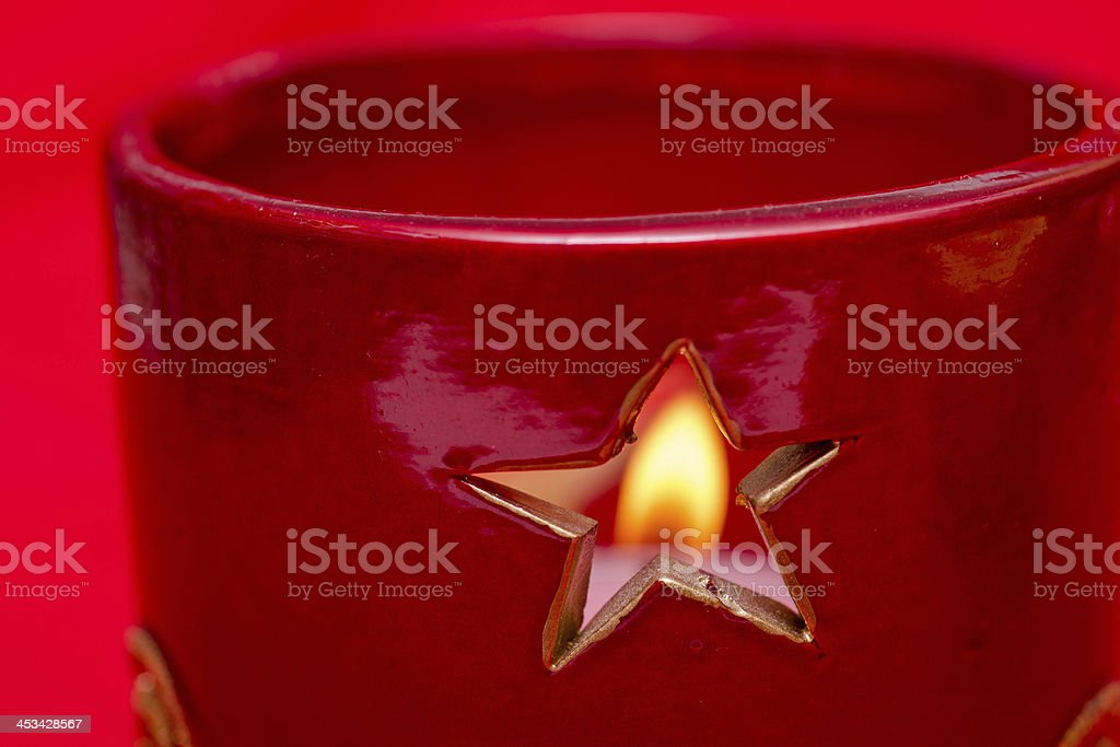 Star of a candlestand with candle light stock photo