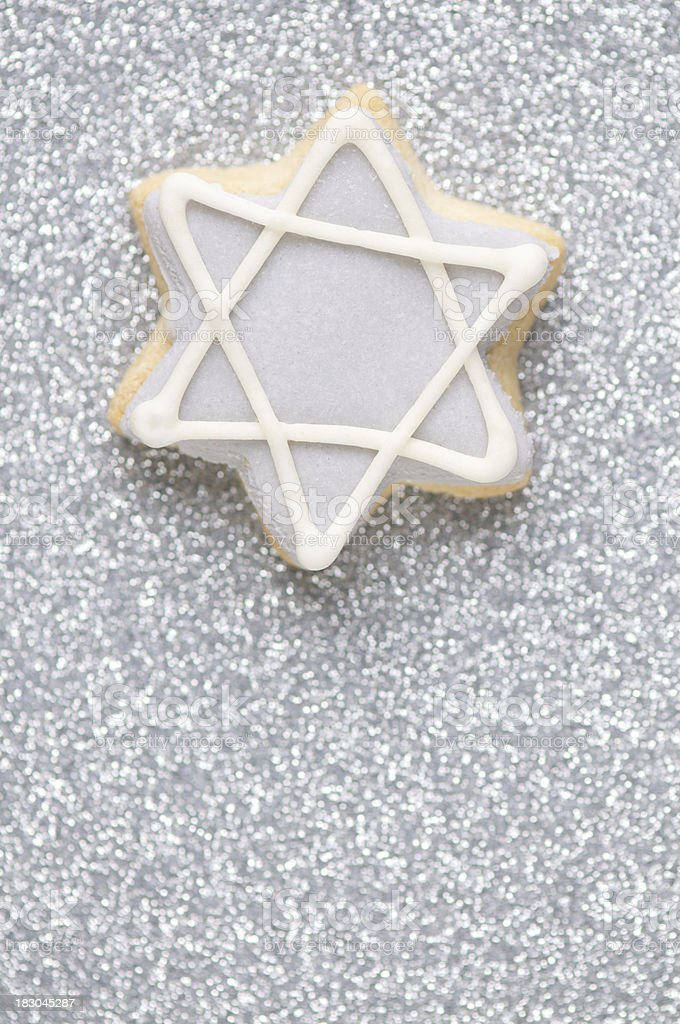 Star of David Cookie on Sparkly Silver Background stock photo