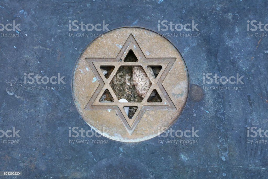 Star of David Jewish symbol at gravestone close up stock photo