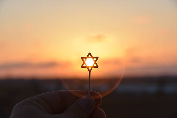 Star of David Silhouette Star of David Silhouette judaism stock pictures, royalty-free photos & images