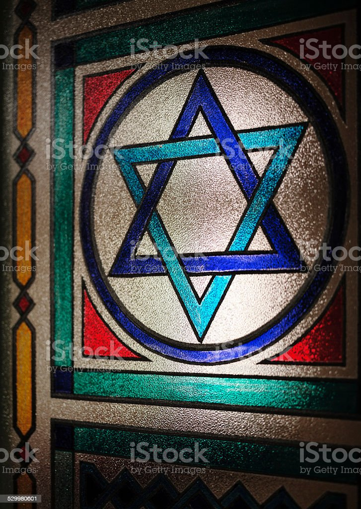 Star of David, Symbol of Judaism on window of synagogue stock photo