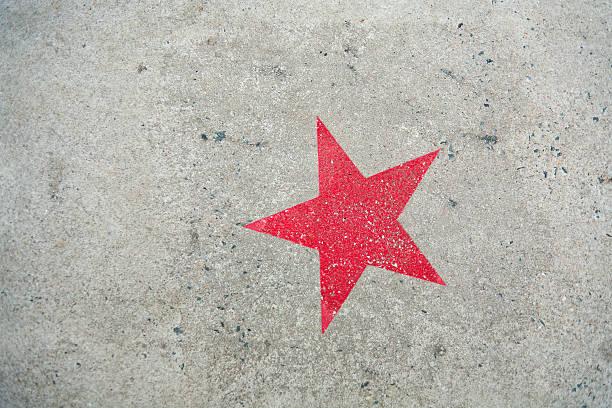 Star on concrete stock photo