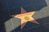 Los Angeles, USA - April 19, 2014: Marilyn Monroe star on Hollywood Walk of Fame in Hollywood, California. This star is located on Hollywood Blvd. and is one of over 2000 celebrity stars embedded in the sidewalk.