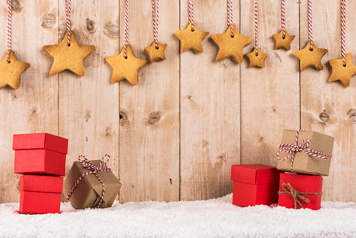 Star Shape Biscuits Hanging Over Presents Stock Photo - Download Image Now