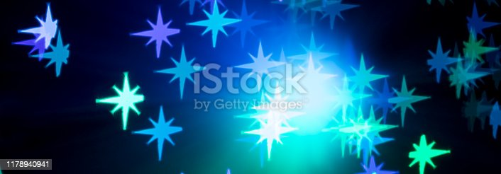 1047386704istockphoto Star shaped bokeh - Christmas background 1178940941