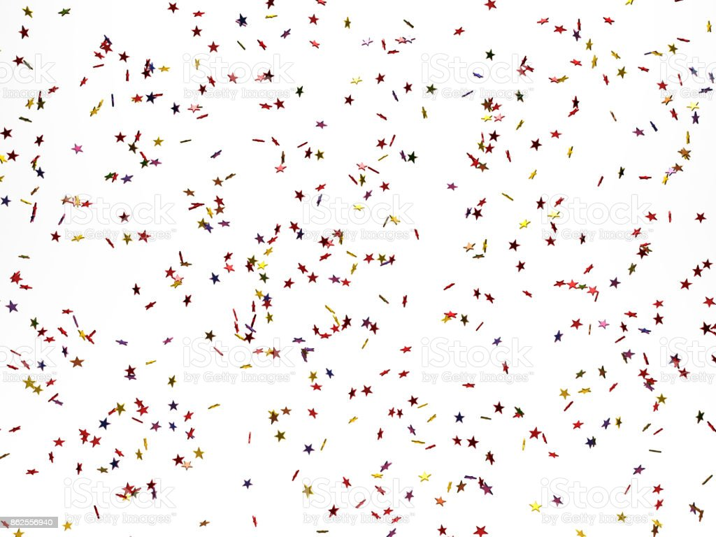 Star Shaped Confetti Falling Over White Background stock photo