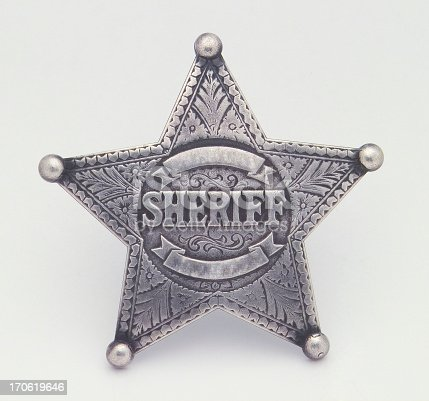 A silver star shaped sheriffs badge Isolated on a white background. Has area's to add additional text such as a name or a badge number. This would be good for any project involving law enforcement, old western designs, or cowboys. If you don't see similar images below please visit my profile.