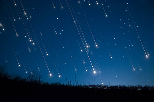 star shower - shooting stars stock photos and pictures