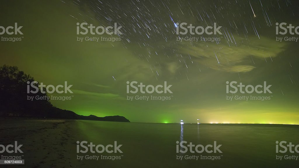 Star trail at Night beach and tropical sea