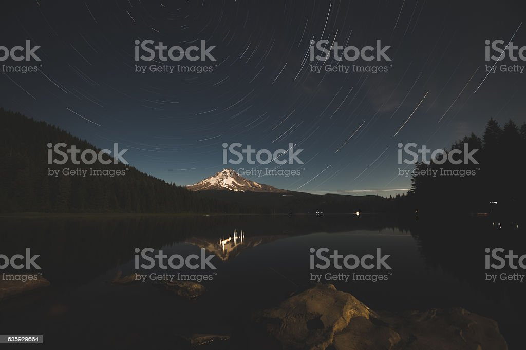 Star Trail Over Beautiful Mountain Lake stock photo