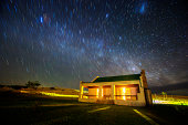 Star trail over country cottage