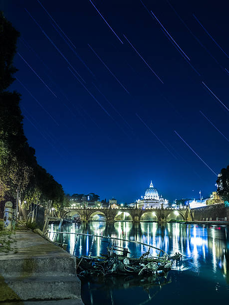 Star trail shot on the Tiber river, Rome, Italy. stock photo