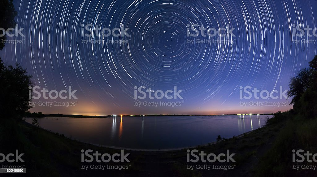 Star trails at the lake stock photo