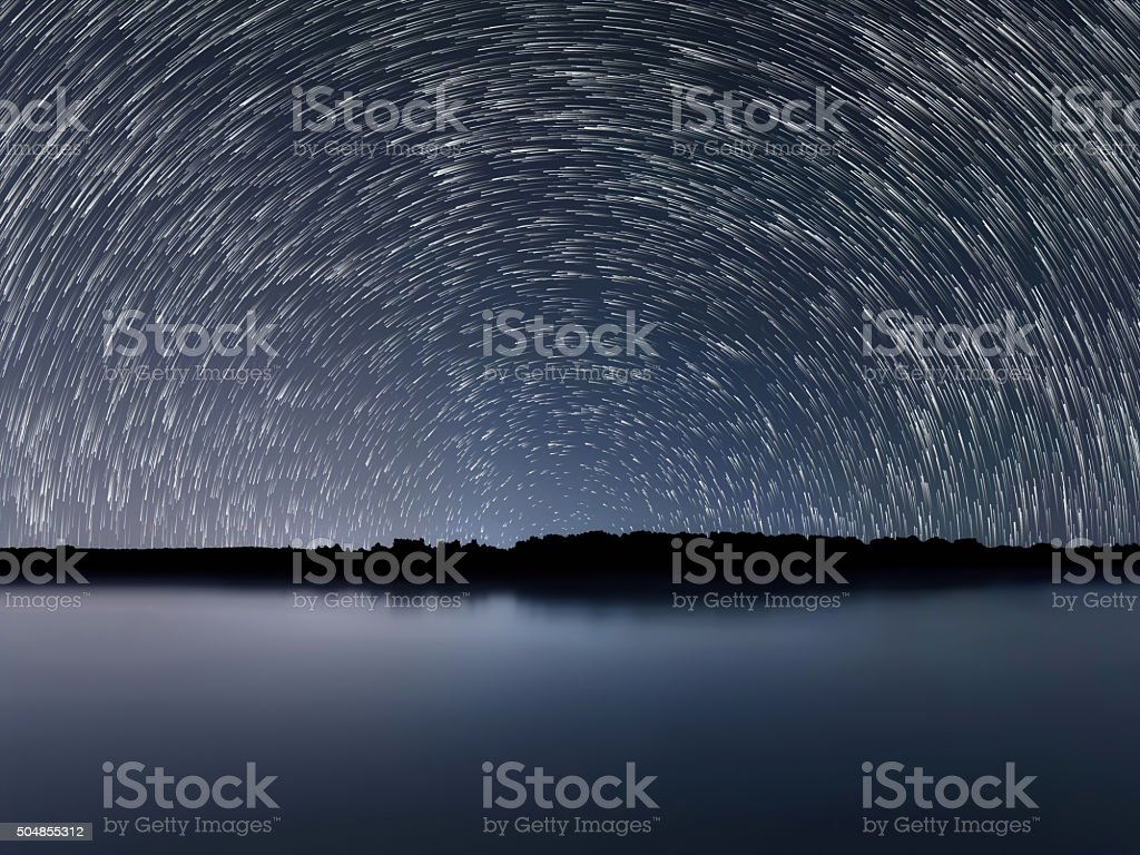 Star Trails, Beautiful Blue Night reflection stock photo