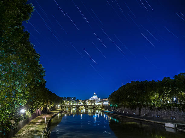 Star trails of Tiber river in Rome, Italy. stock photo