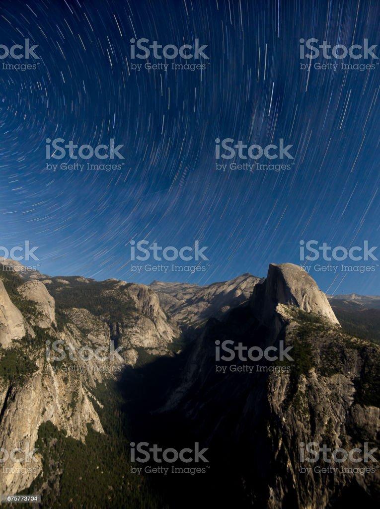 Star trails over Half Dome stock photo