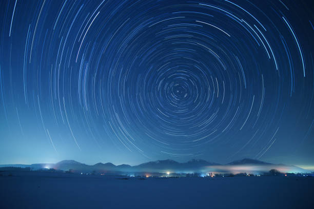 Star trails over Mt. Hiruzen and Mt. Daisen in winter Star trails over Mt. Hiruzen and Mt. Daisen in winter. These mountains are famous sightseeing spots in Chugoku district, Japan. north star stock pictures, royalty-free photos & images