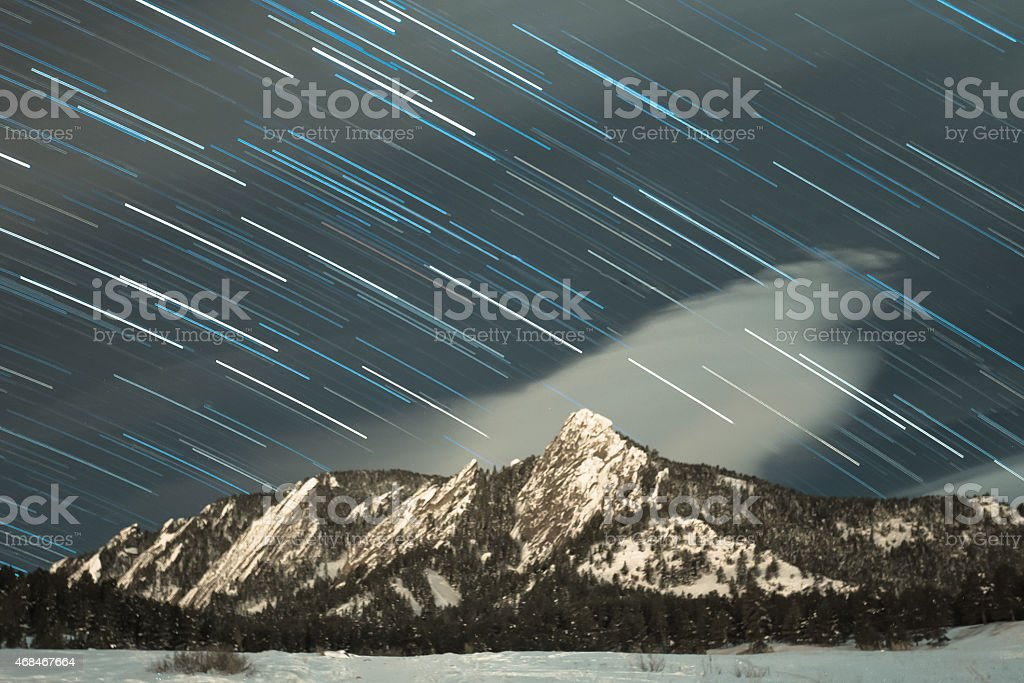 Star Trails Over the Flatirons in Boulder Colorado stock photo