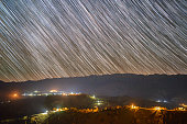 istock Star trails over the Pestera village in Piatra Craiului mountains from Romania 1221420487