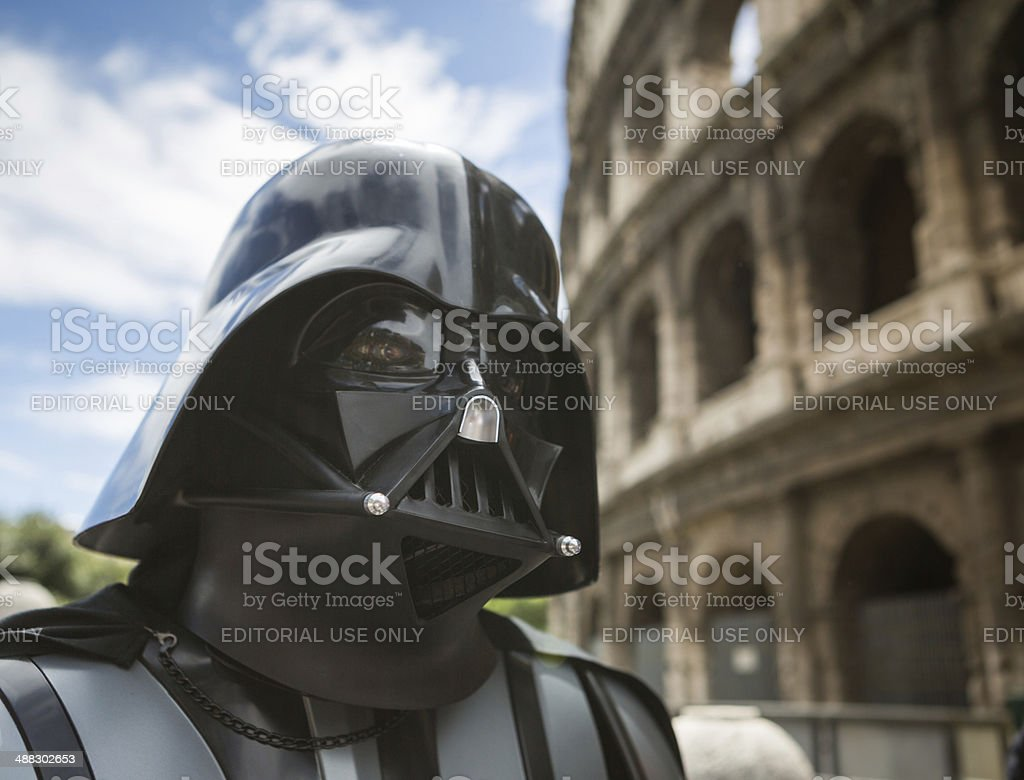 Star Wars Day 2014 in Rome Rome, Italy - May 4, 2014: Star Wars Day 2014 in Rome: Darth Vader posing in front of the Coliseum Arts Culture and Entertainment Stock Photo