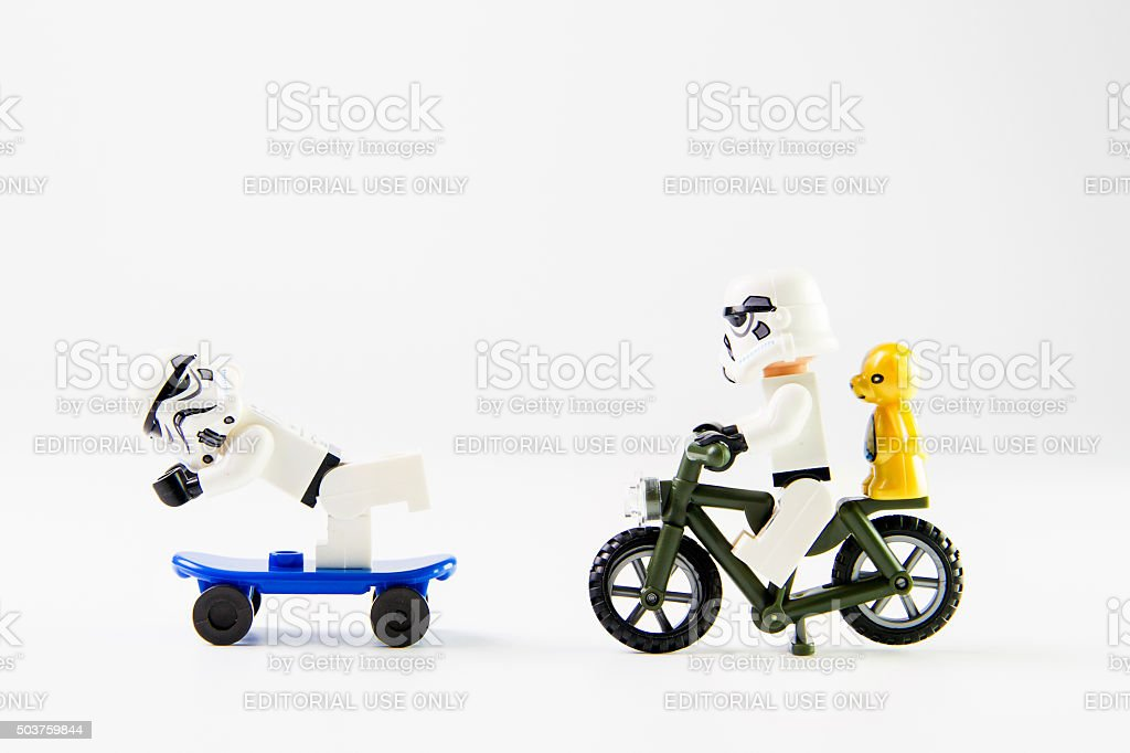 Star Wars movie : Stomtrooper ride a bicycle and Skateboarding stock photo