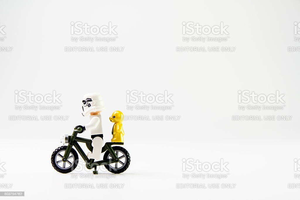 Star Wars movie : Stomtrooper ride a bicycle stock photo
