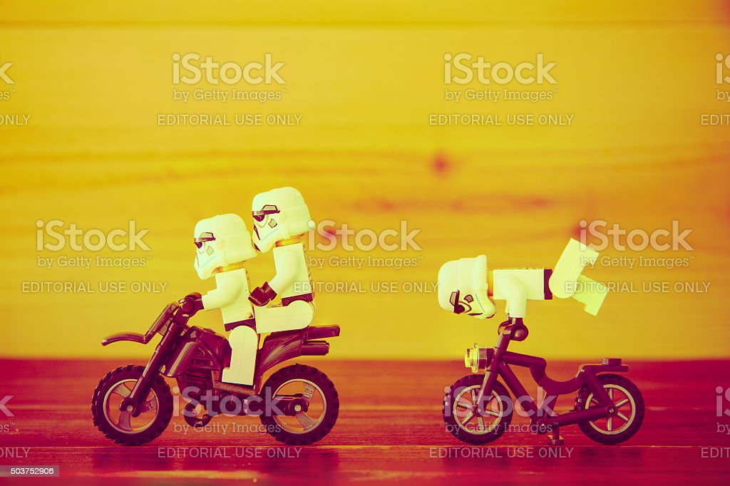 Star Wars movie : Stomtrooper ride a motorcycle and bicycle stock photo