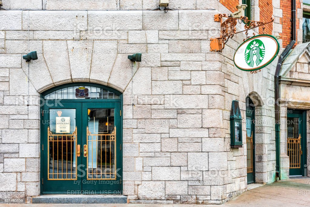 Starbucks cafe restaurant sign entrance at Chateau Frontenac stock photo