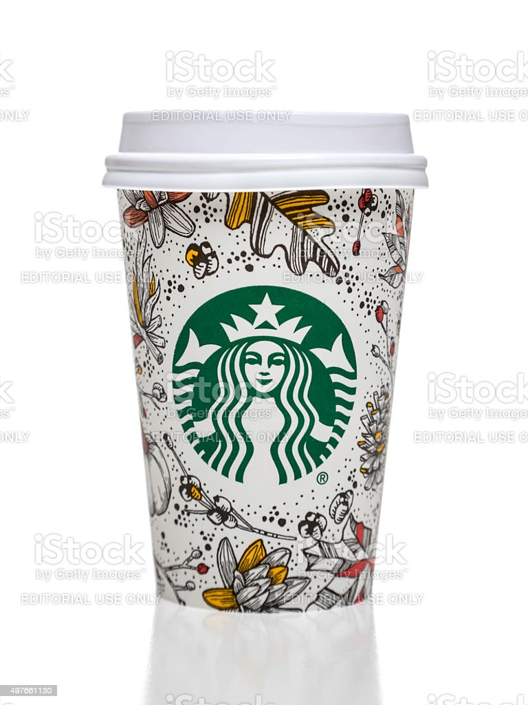 Starbucks coffee cup with autumn decorative motives stock photo