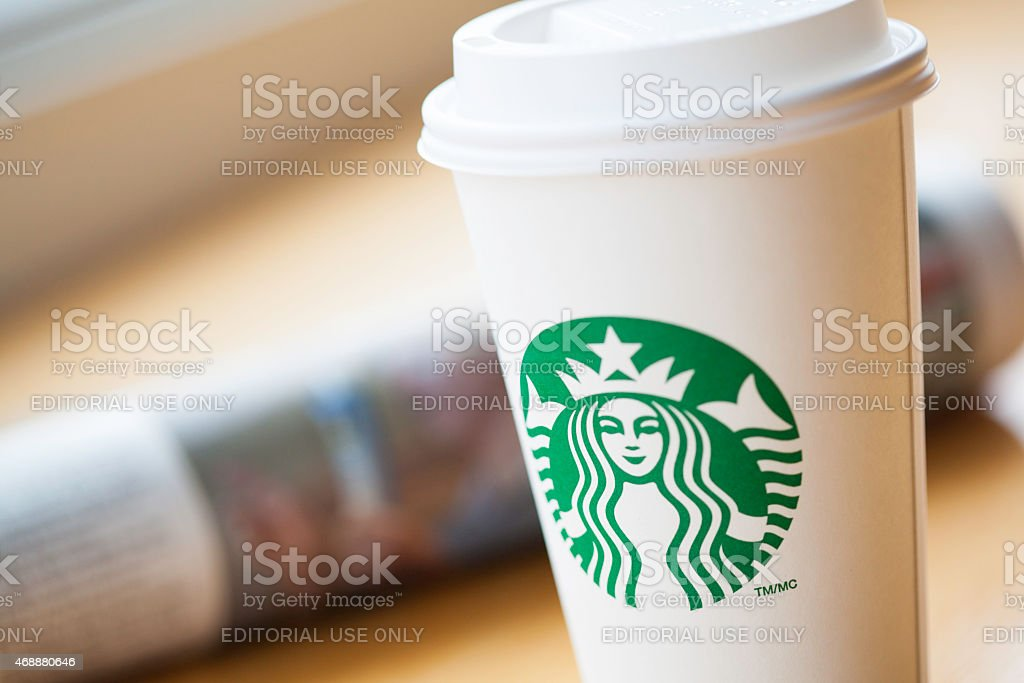 Starbucks Coffee Cup with Newspaper stock photo