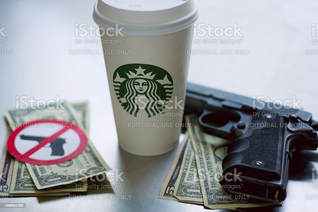 Starbucks, Coffee, Money and Guns royalty-free stock photo