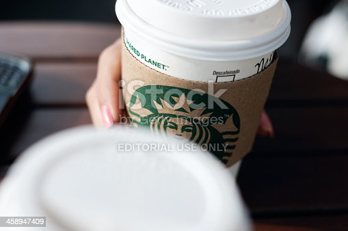 La Libertad, El Salvador - April 30, 2012: A disposable coffee cup with the Starbucks franchise logo on it.